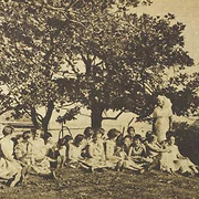 The matron and medical superintendent, extreme right, supervise some of the children in the grounds of the Sunshine Home, Gore Hill, North Sydney