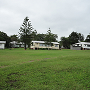 View of four of the five cottages from the west. In the foreground is the site of the original cottage dormitories