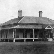 Boys standing on the verandah of the Queensland Home for Boys, Riverview