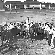 Child migration - British youth migrants learning how to mount and ride a horse at the Salvation Army Training Farm for Boys, Riverview, Queensland.