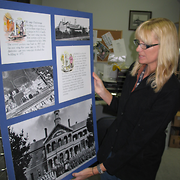 Sharon Guy, Heritage Worker, with Ballarat Orphanage Exhibition Board